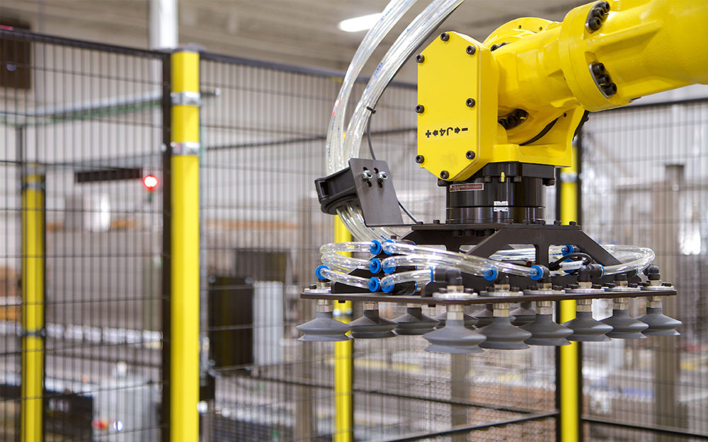Automated robotic arm with suction cups