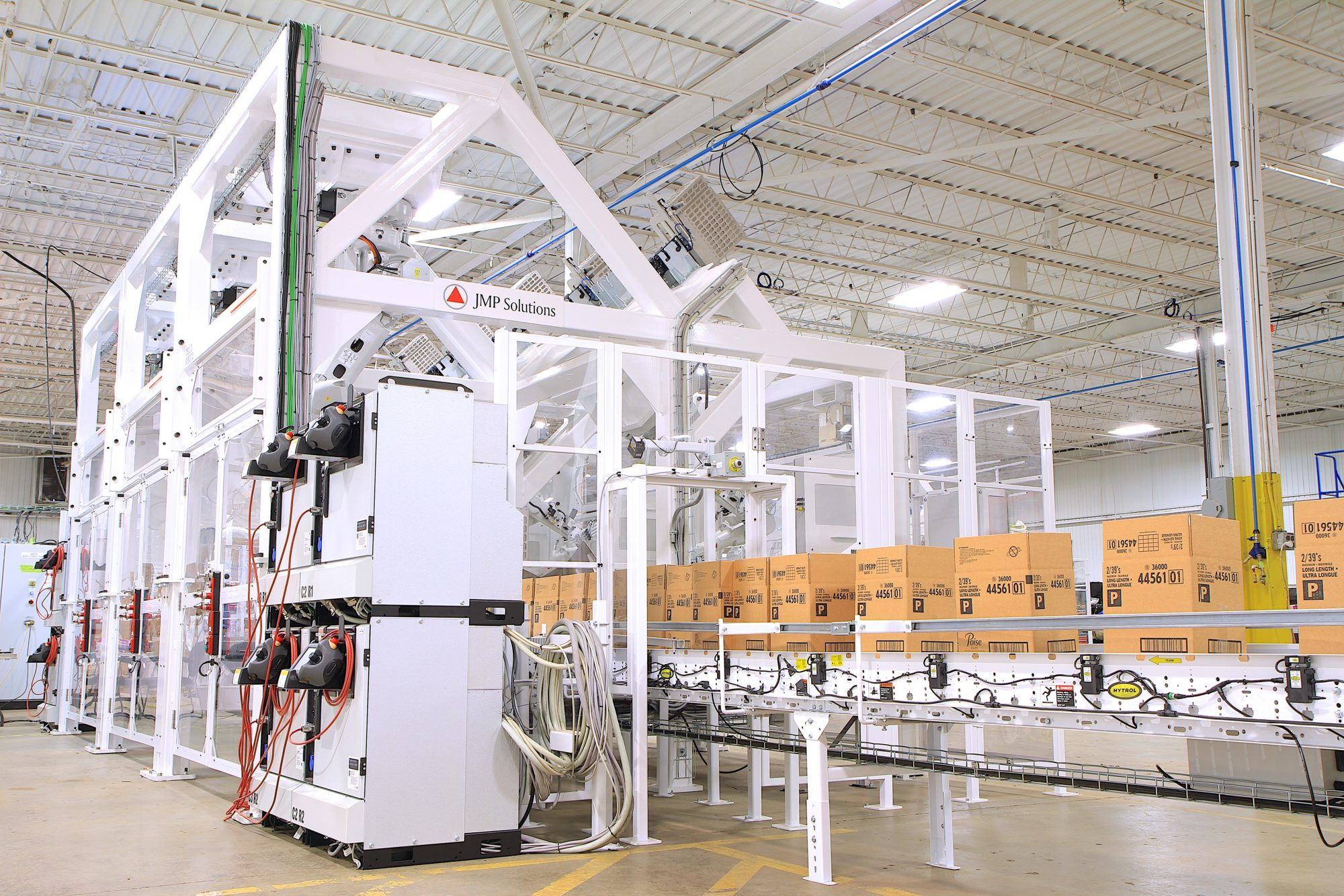 Collating case packer system with boxes in motion