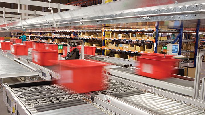 Product moving on warehouse conveyor rollers