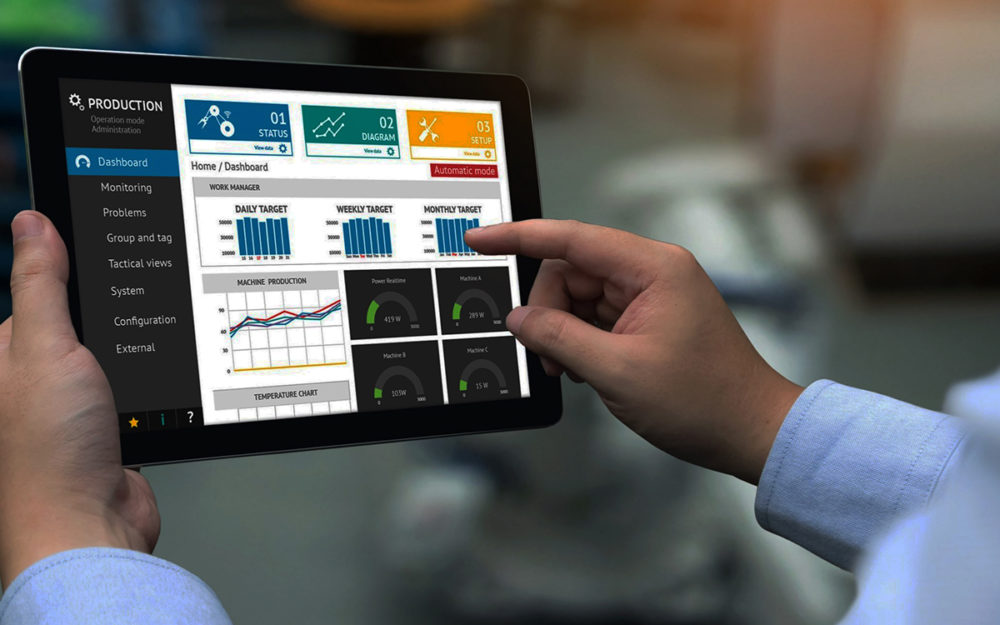 Man point at production dashboard on a tablet