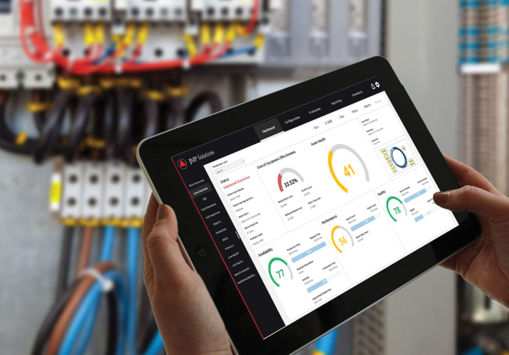 Control panel with engineer measuring performance on tablet