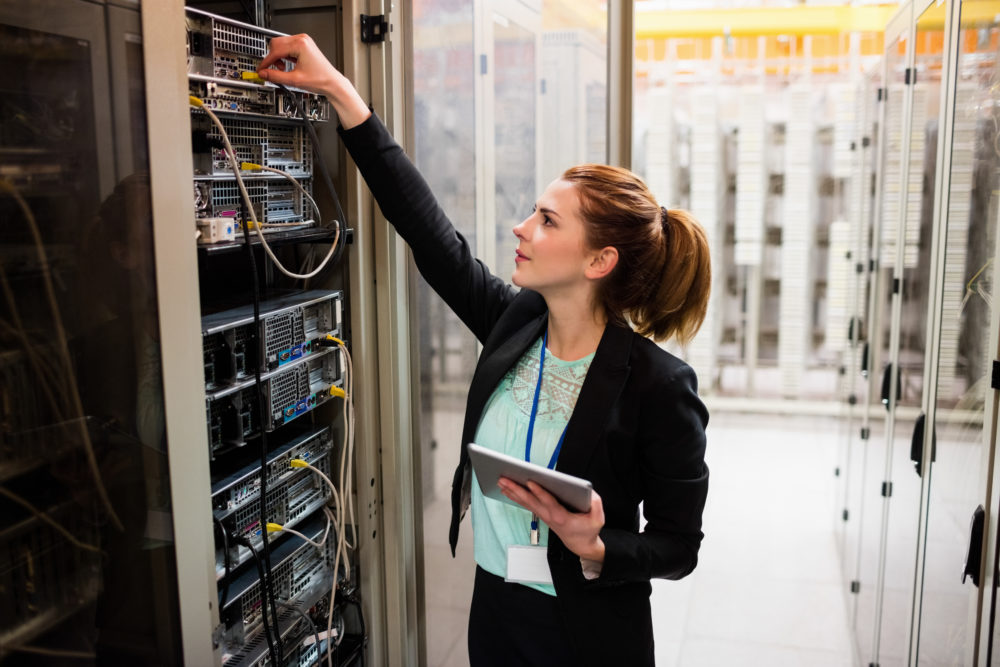 Woman working on data center