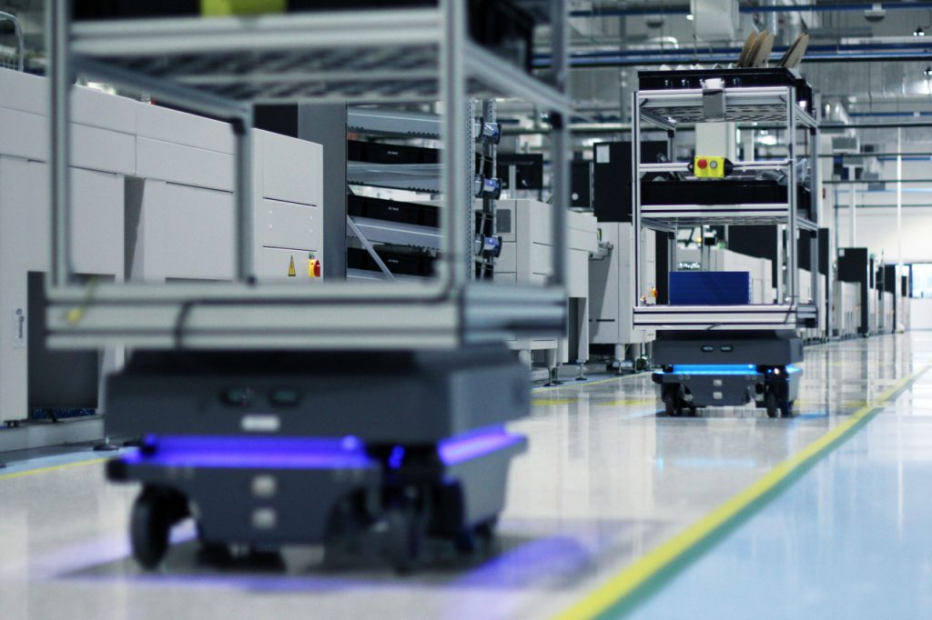 Automated Guided Vehicles moving material on production line