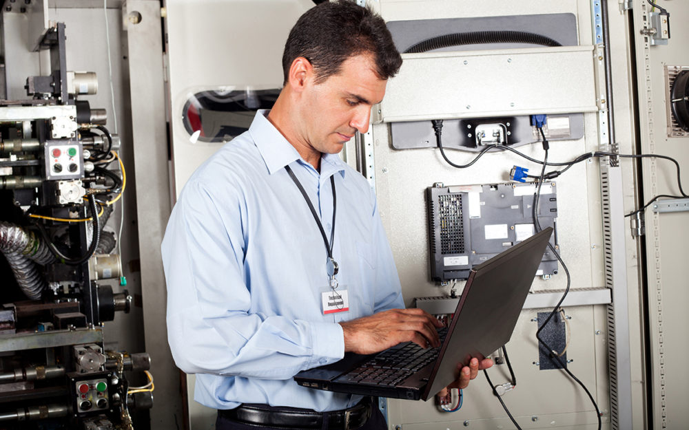 Male engineer working on control panel