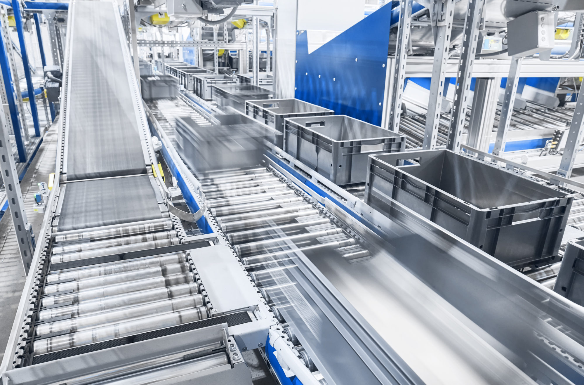 Modern conveyor system with boxes in motion