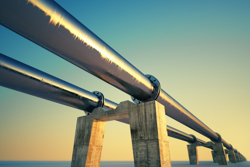 Bottom shot of a pipeline at sunset