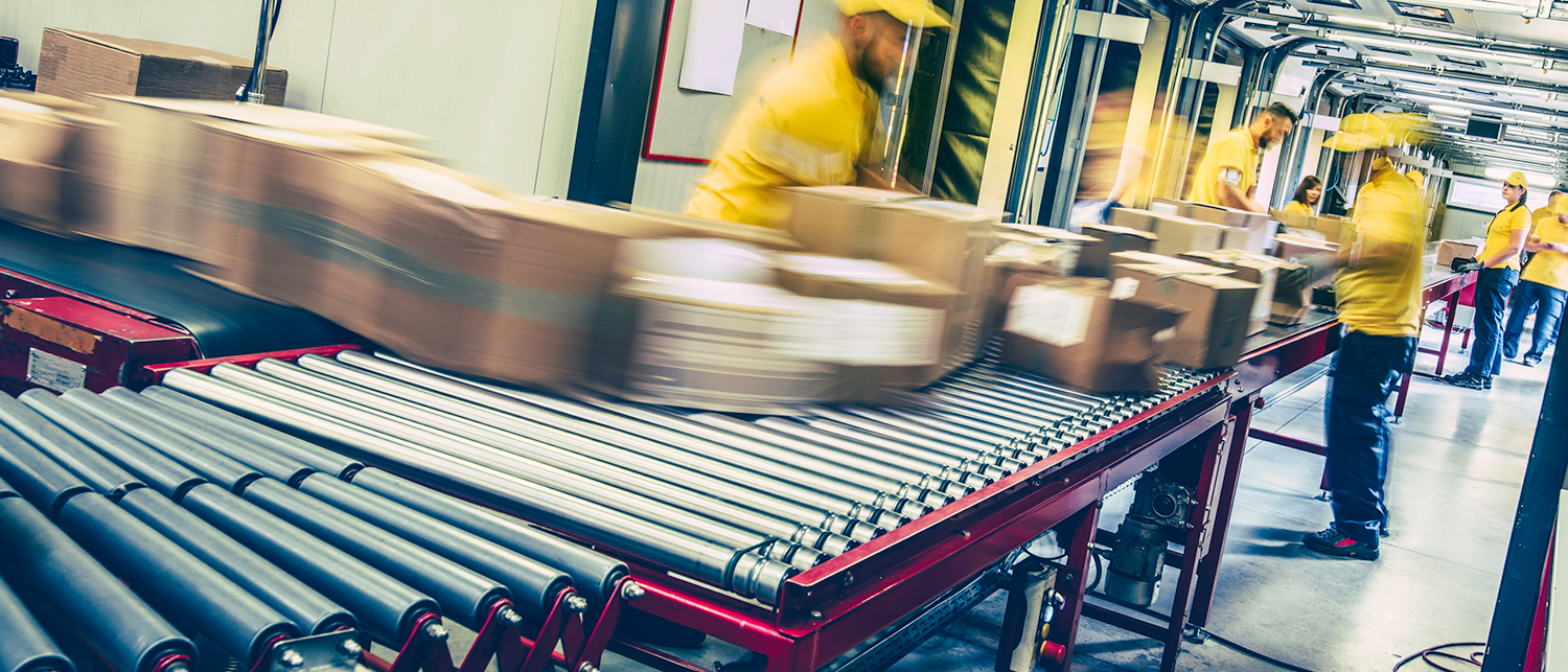Boxes in motion on conveyor rollers