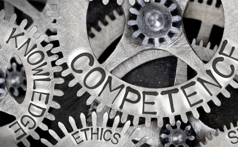 Gears with the words competence, ethics and knowledge
