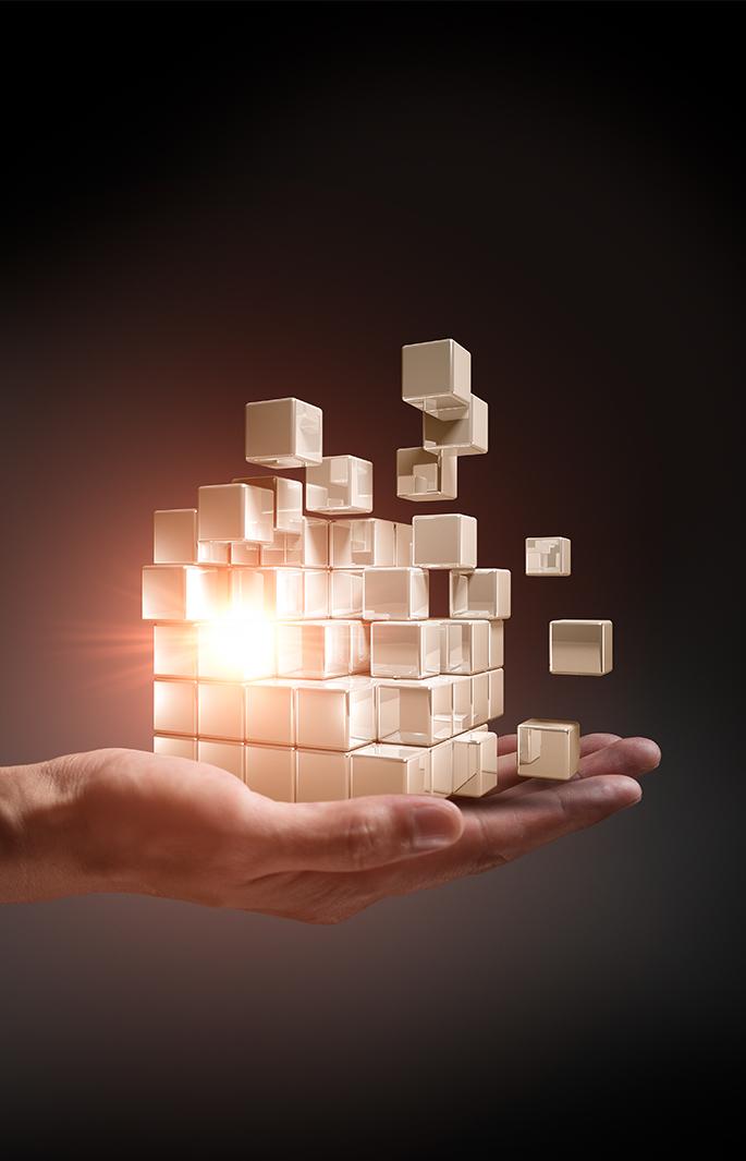 Hand holding building blocks